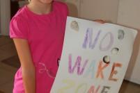 Sara proudly displays her No Wake Zone sign