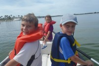 Wes, Gabby, and Nikolai canoeing over goliath grouper habitat in San Carlos Bay